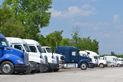 PS Logistics trucks in a parking lot