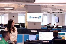 BlueGrace Logistics' employees sitting at their desks