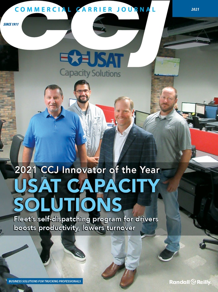 Blair Ewell (left), USA Truck senior vice president of operations; Josh Shader, director of network planning and execution; James Reed, CEO; and Sam McCain, senior director of truckload, led the effort to put more control in drivers' hands.