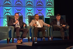 John Thomas, left, and Cedric Daniels, middle, discuss the future of fueling trucks with CCJ Editor Jason Cannon.