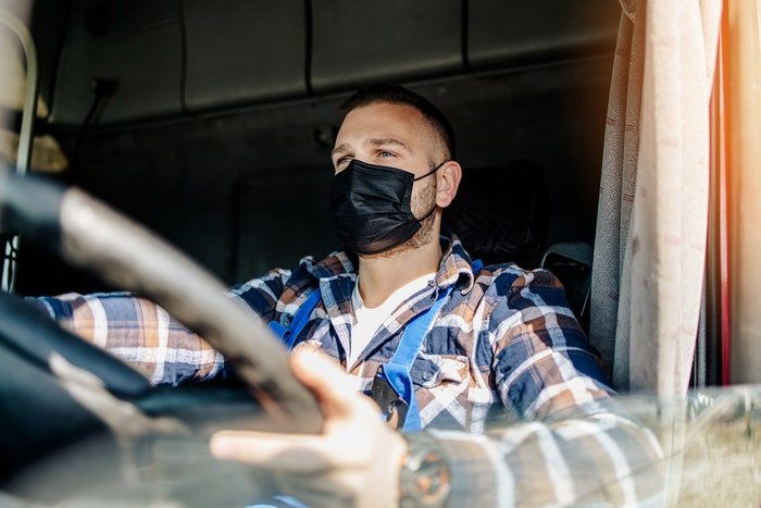 truck driver with a mask