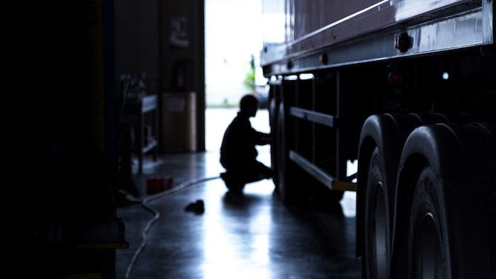 Technician working on truck tire