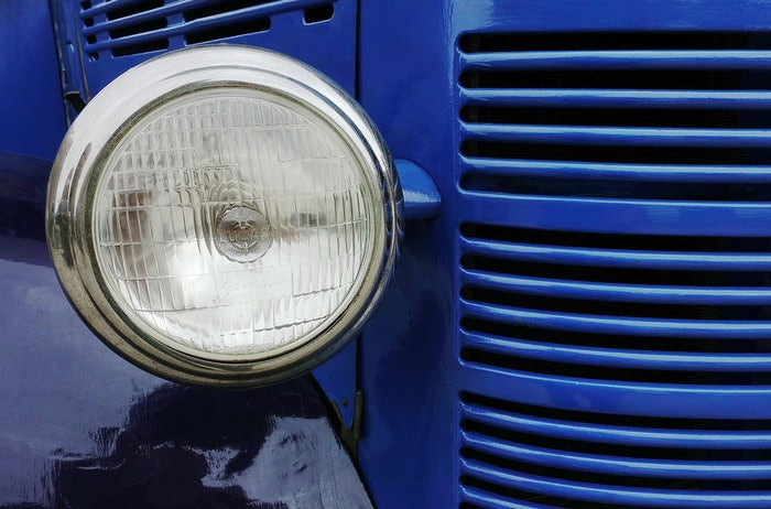 headlamp on a blue semitruck