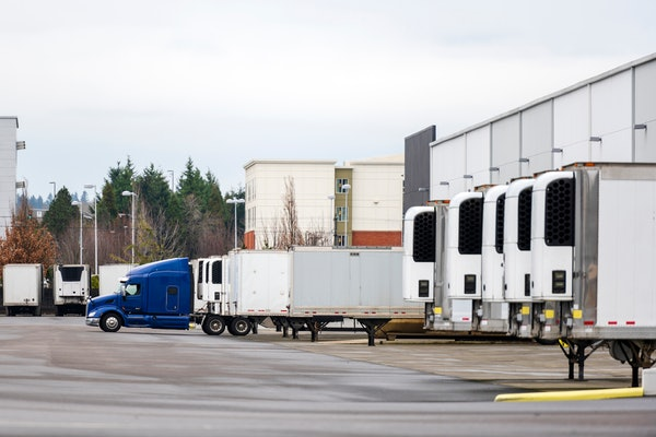 Reefer trailers at a dock