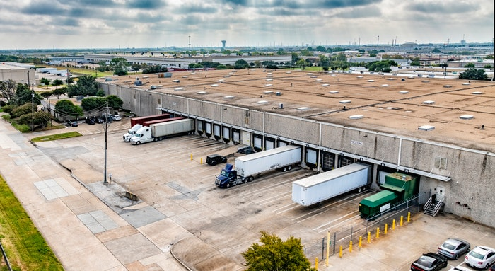 trucks and trailers being loaded at a warehouse