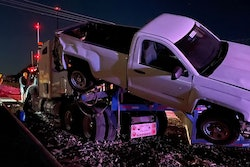 A car hauler was smashed in Oklahoma on Friday after following GPS onto the tracks where the low-riding trailer became stuck.