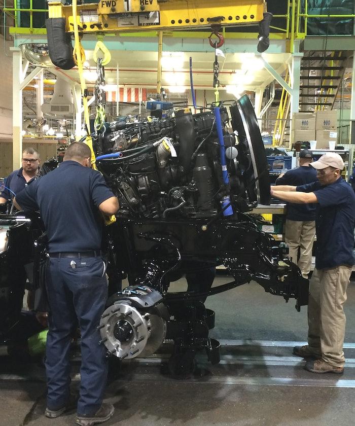 Paccar technicians building a truck