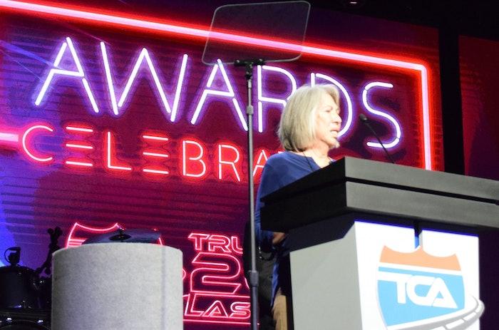 Betty Aragon accepting an award