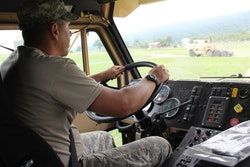 A soldier in the National Guard drives a truck